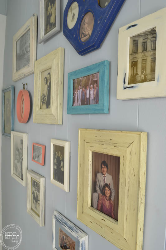 By using picture frames purchased at garage sales and thrift stores, it's easy and cheap to create a custom gallery wall!