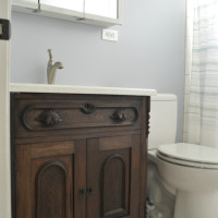 bathroom with antique dresser as vanity