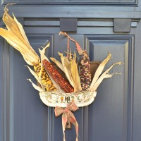 Unique fall wreath created with natural elements and vintage finds | Dustpan wreath | Upcycled dustpan as a front door hanging