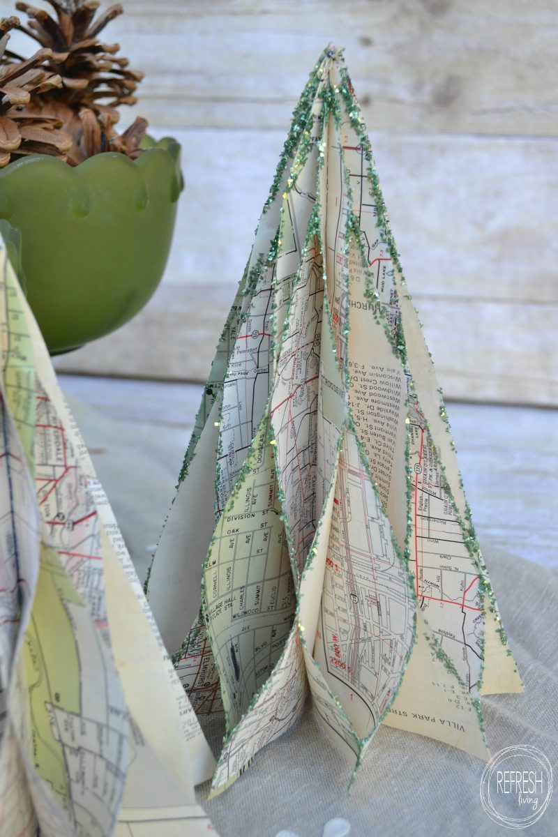 Vintage map christmas trees refresh living for Christmas tree made from old books