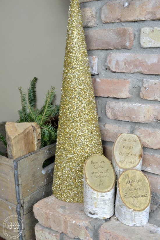 birch log pillars with christmas song lyrics