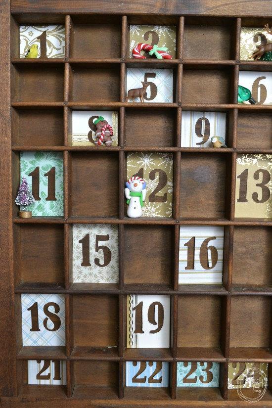 What a cool idea for an advent calendar - use a vintage printer's tray!