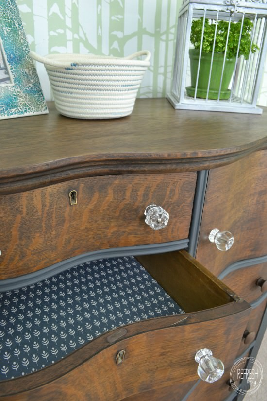 painted and stained antique two toned dresser with lined drawers paper and fabric