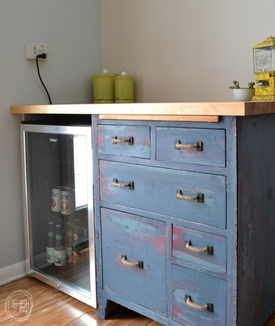 custom beverage center with mini fridge and antique dresser