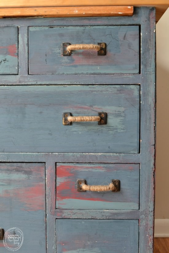 distressed dresser with 3 layers of paint