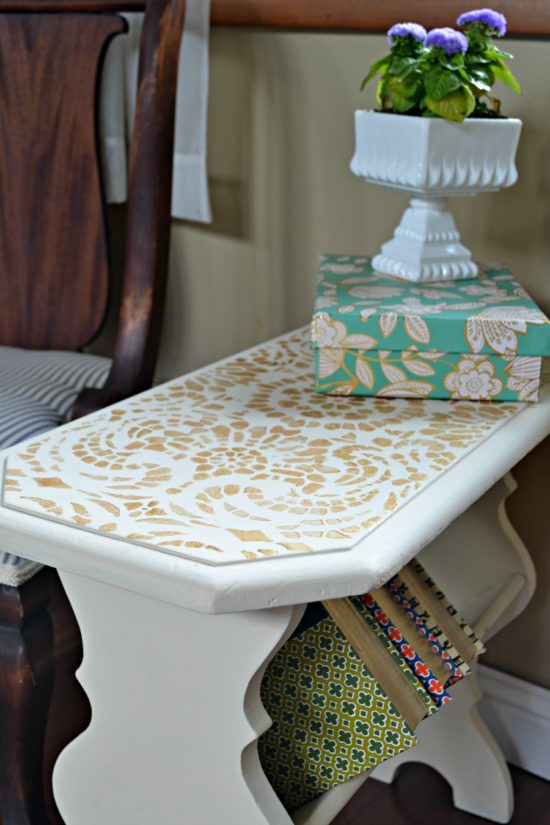 side table painted in cream with gold accents