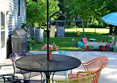 Create a backyard on a budget by painting a used patio set