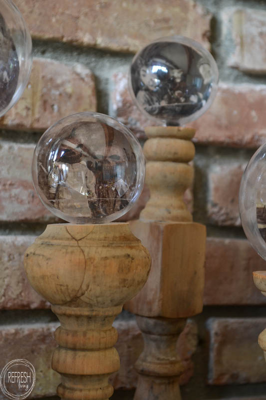 Using vintage Halloween images, old spindles, and dollar store ornaments, it's easy to create these crystal ball DIY Halloween decorations.