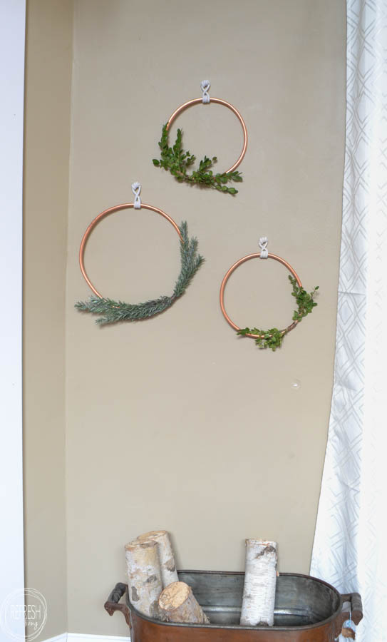 What a great idea to use copper tubing to make a wreath! I love the look of the natural greenery of boxwood and evergreen and the copper..