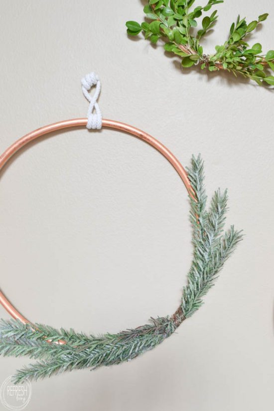 This would be such an easy DIY Christmas wreath!I love the contrast between the copper and greenery.