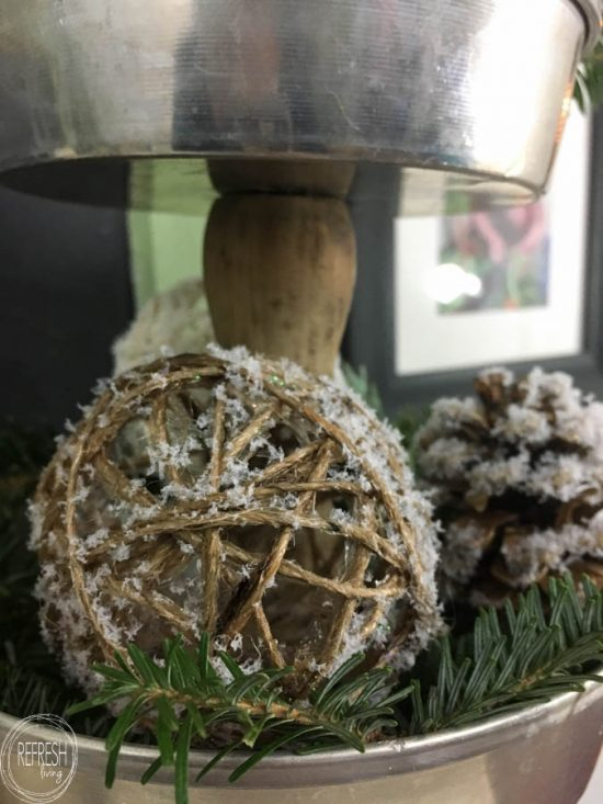 Wrapping twine around water balloons create the perfect shaped rustic twine or string balls to use an fillers for centerpieces or holiday decor.