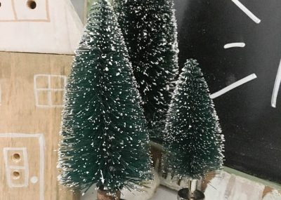 What a great way to display bottle brush trees! Instead of those ugly plastic bases, sit them in vintage door knobs or fun drawers pulls or knobs.