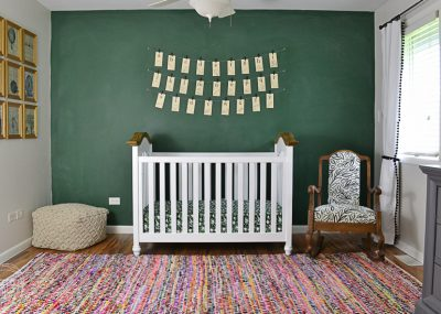 This nursery is filled with fun vintage finds to create a modern spin on a vintage classroom. I love the green chalkboard wall!