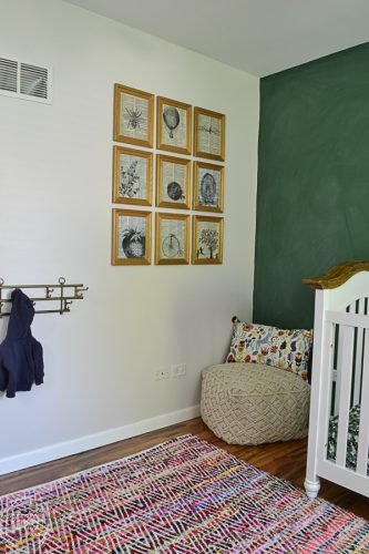 Large art display with individual frames with dictionary page art and printed vintage illustrations.