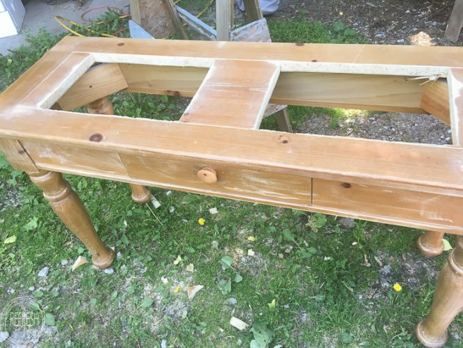 An old sofa table can be reused as a DIY raised garden bed! This is such an easy outdoor project!