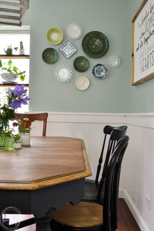 Room makeover completed for under $100 - including a new table and chairs! Vintage modern farmhouse dining room with plate gallery wall and DIY wood sign with quote.